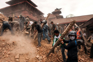Nepalis clear rubble following the country's devastating earthquake.