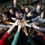 INASP staff joining hands to support International Women's Day.