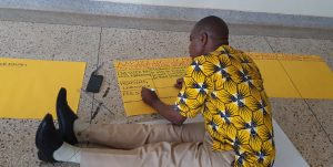 Working on course outline at Gulu University.